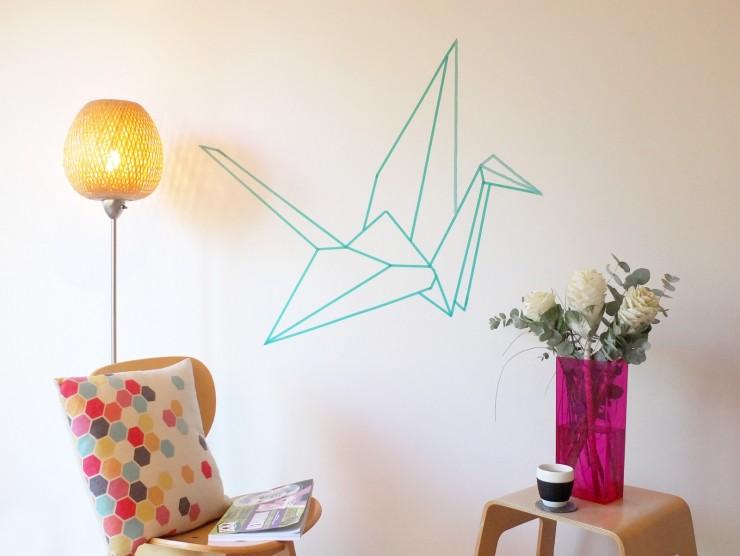 Masking tape origami sur un mur