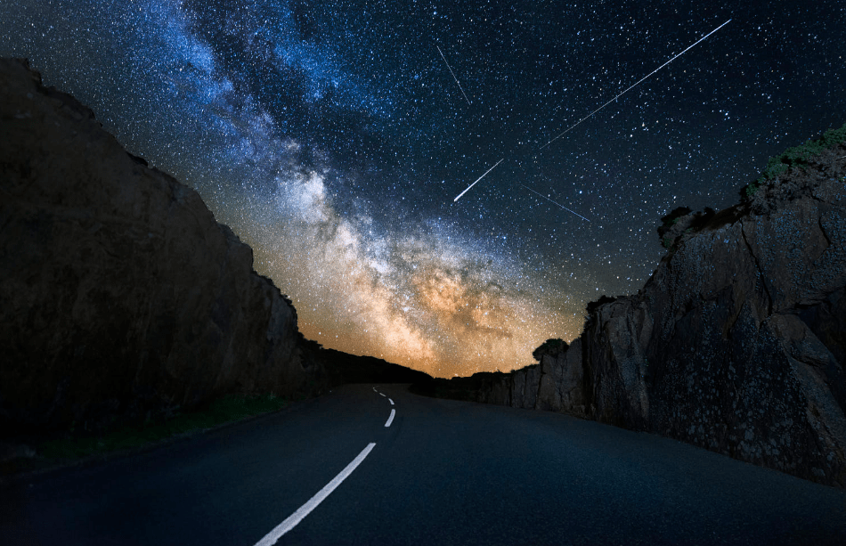 The Milky Way and meters over the Road to Corbiere Lighthouse in Jersey, Channel Islands. Photo by Nick Venton