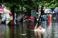 children playing on flood
