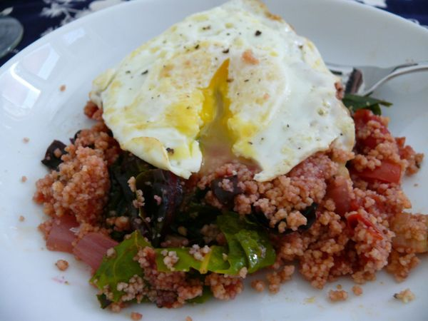 eggs on chard & tomato couscous