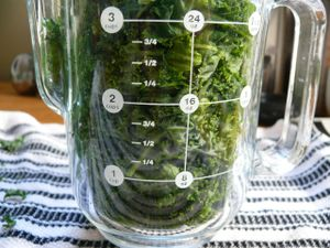 three packed cups of kale...