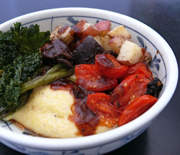 herb roasted vegetables and gravy, with crispy kale on creamy polenta