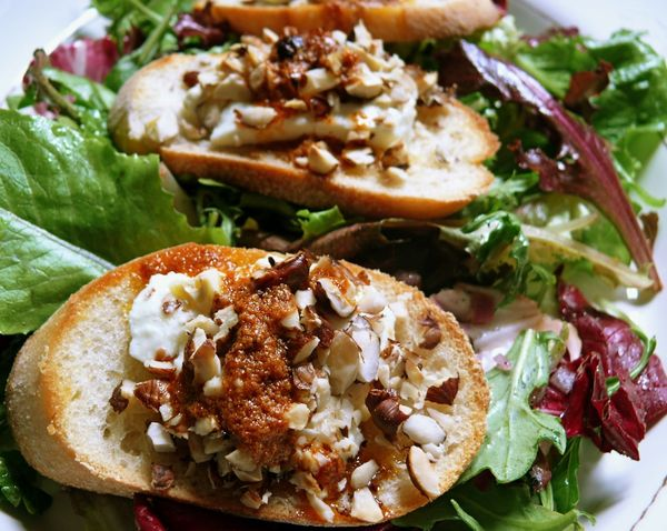 salad with hazelnut goat cheese toasts and paprika oil