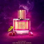 Parfum Cherry of Cashmere dans un flacon d'exception de la marque Les Fleurs du Golfe. Sur fond violet avec des cerises et des pierres précieuses à coté.