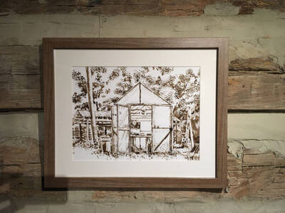 The greenhouse prim, inked, and framed on display.