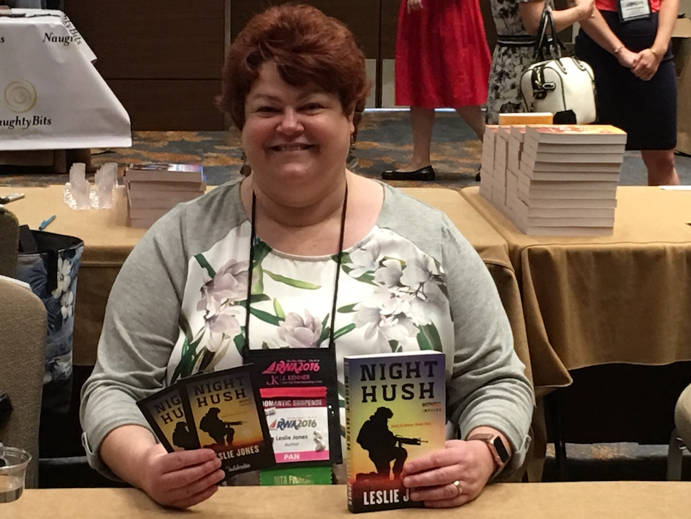 Leslie holding copies of Night Hush at RWA 2016's Literacy Book Signing