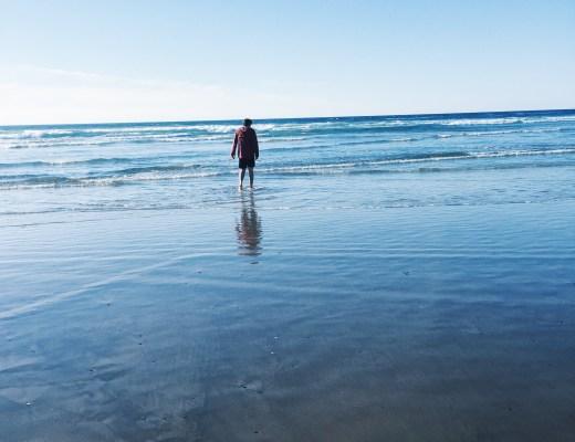 Reed wading in the ocean, Oregon Coast