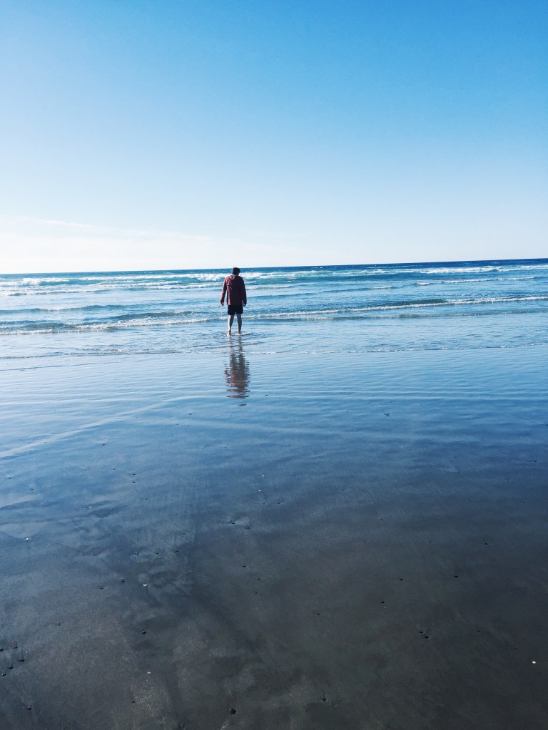 Reed wading in the ocean, Oregon Coast