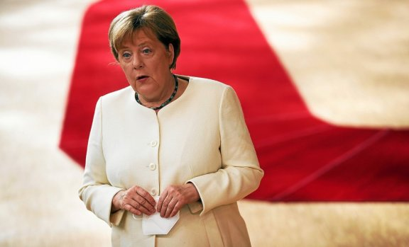 Germany's Chancellor Angela Merkel arrives for a meeting of an EU summit on a coronavirus recovery package at the European Council building in Brussels on July 19, 2020 An acrimonious EU summit...