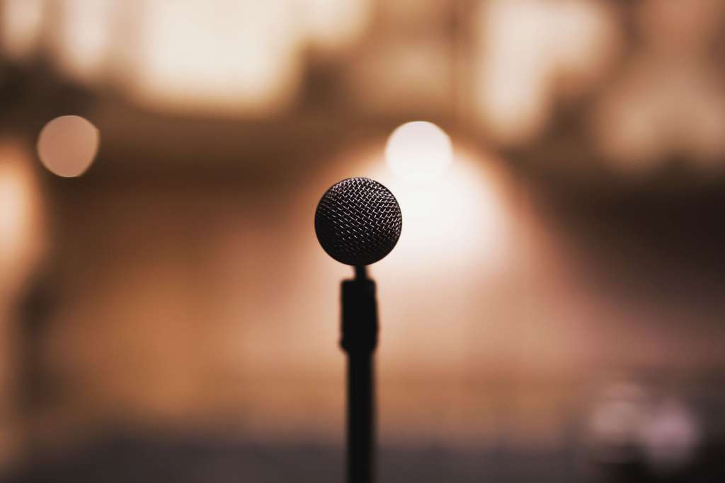 Perspective of a microphone waiting to speak