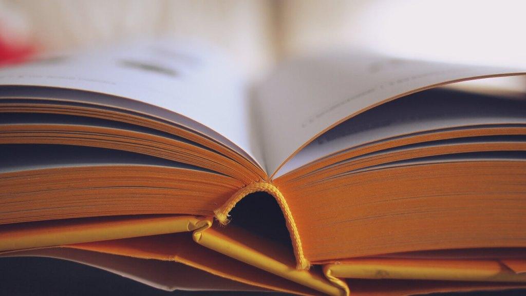 open book binding in yellow