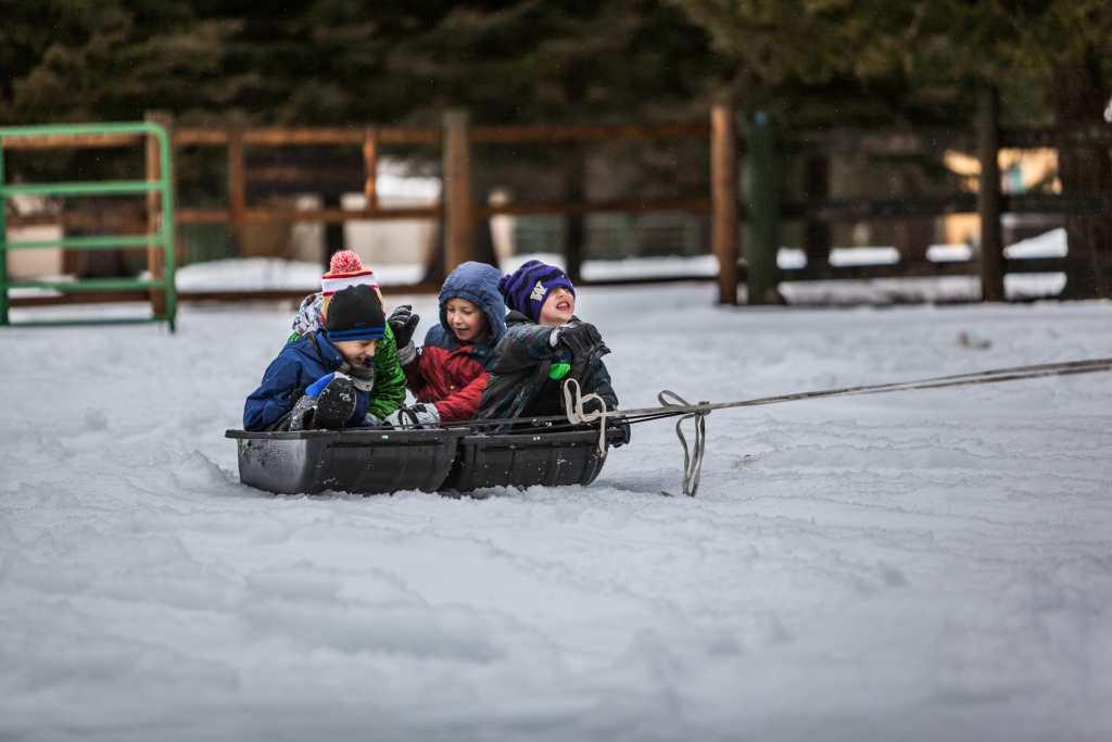 Affordable Family Winter Getaways - Kids Sledding
