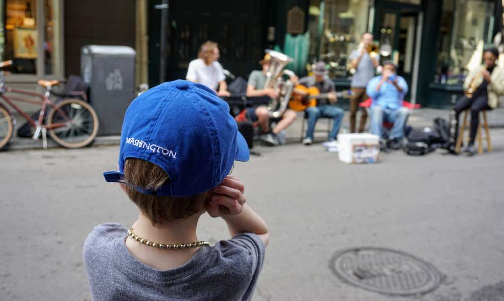 French Quarter with kids - New Orleans street musician