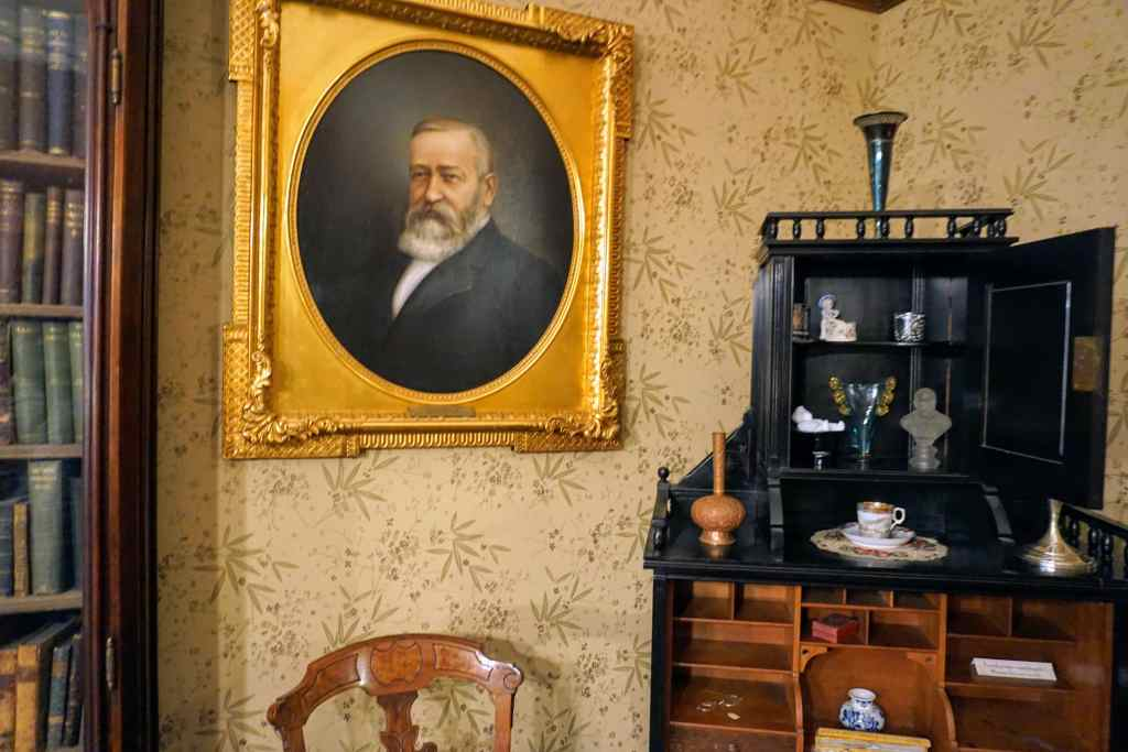 Visiting Benjamin Harrison House - portrait of Benjamin Harrison and Mrs. Harrison's desk