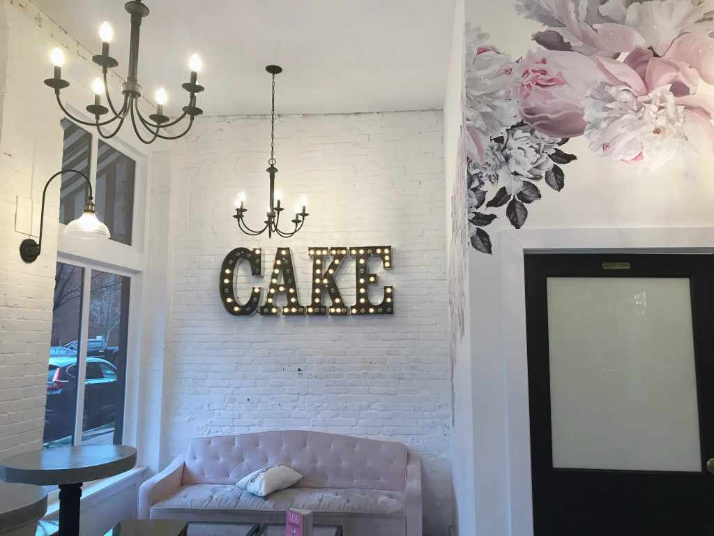 The Sweet Divine bakery wall with Cake sign