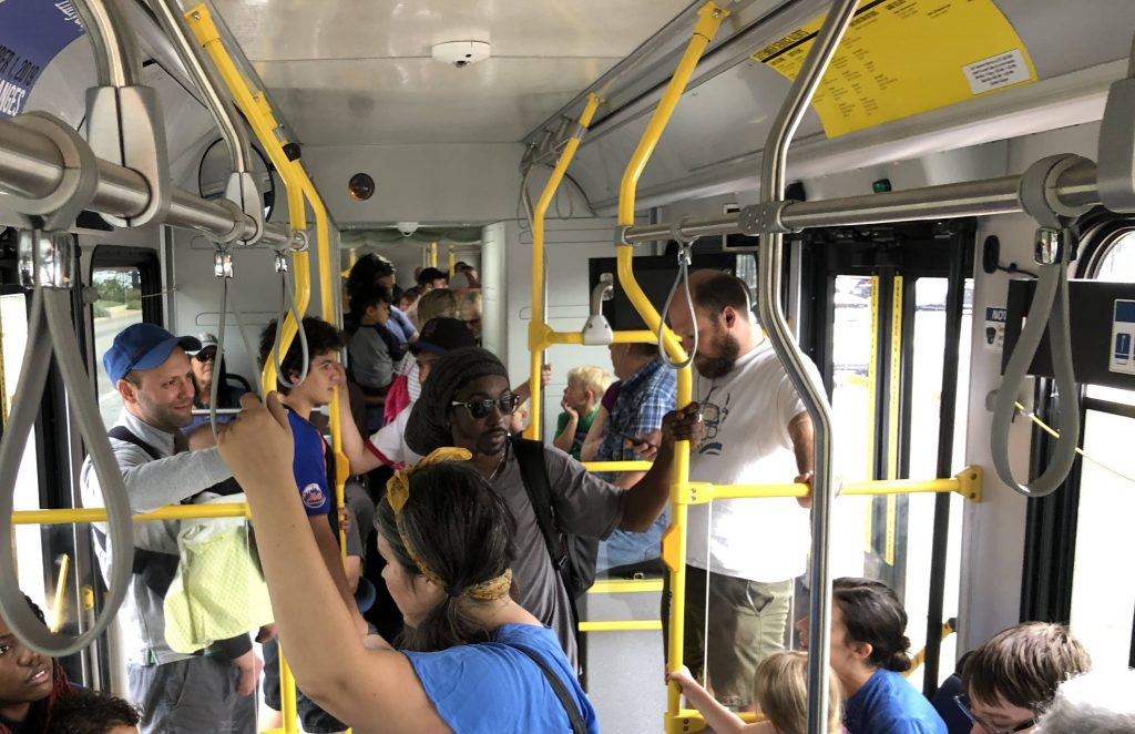 Red Line with Kids - crowded bus interior