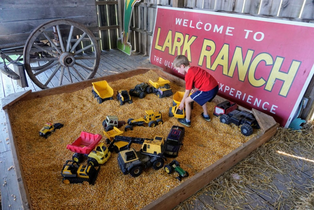 Fall activities in Indianapolis - child playing in Lark Ranch corn box