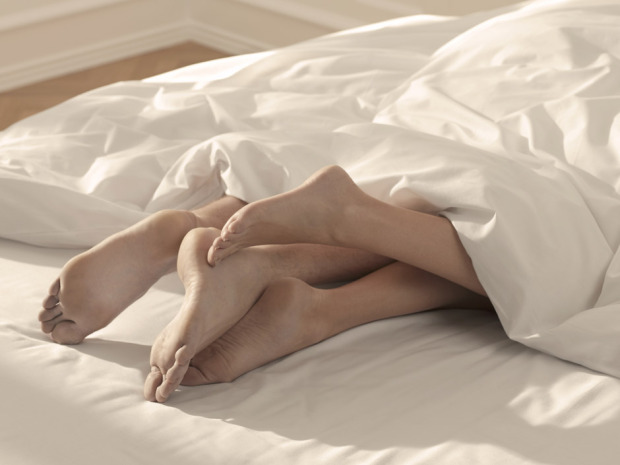 Local Input~ Legs in bed // // **FOR NATIONAL POST USE ONLY - NO POSTMEDIA** UNDATED -- infidelity cheating spouse man woman wife husband couple together sex cuddle cuddling intimacy CREDIT: GETTY IMAGES/THINKSTOCK (FOR NATIONAL POST USE ONLY)/pws na012015-women
