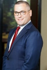 A photo of a man in business dress to the waist down, an example of a bad crop for a LinkedIn headshot.