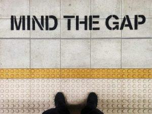 A photo of text at a subway station reading