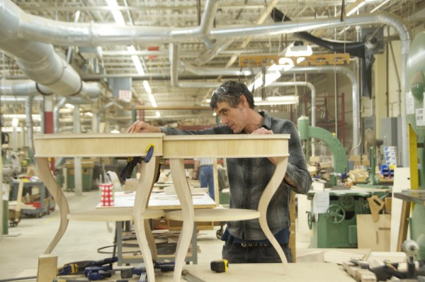Tom Shields working on the factory floor during his artist in residence at Century Furniture