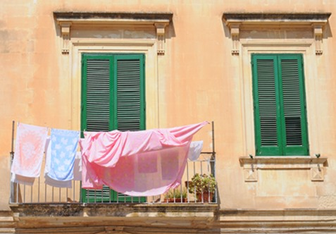 Laundry on clothesline in the street, Lecce, Italy