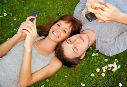 Couple with mobile phones outdoors