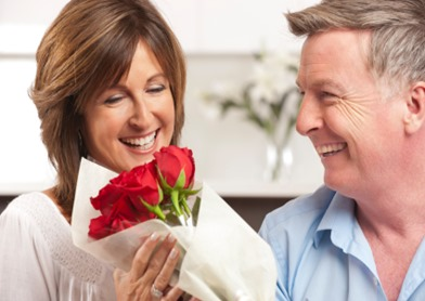 Man giving his happy wife red roses