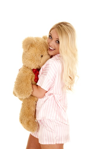 woman blond pajamas bear hug smile