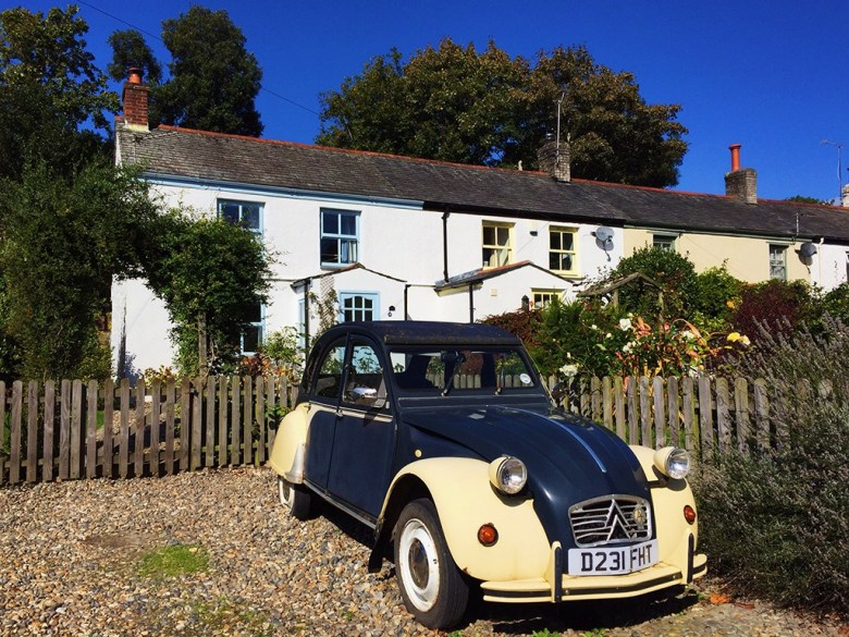 Beautiful White Cottage and Retro Car