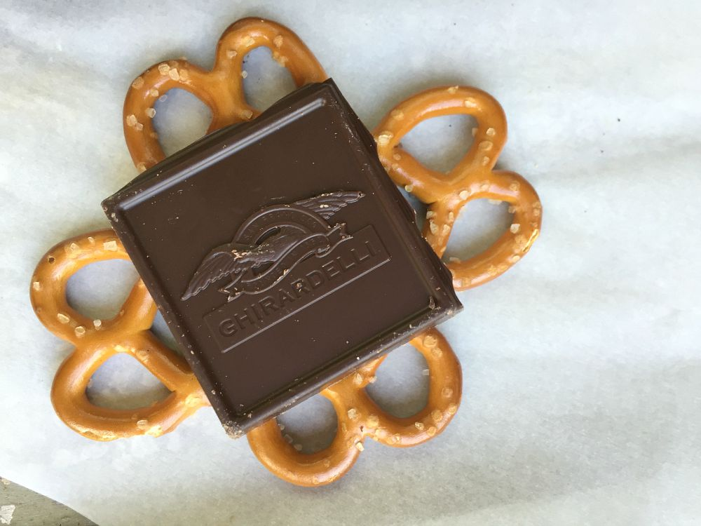 A square of chocolate with 4 pretzels underneath