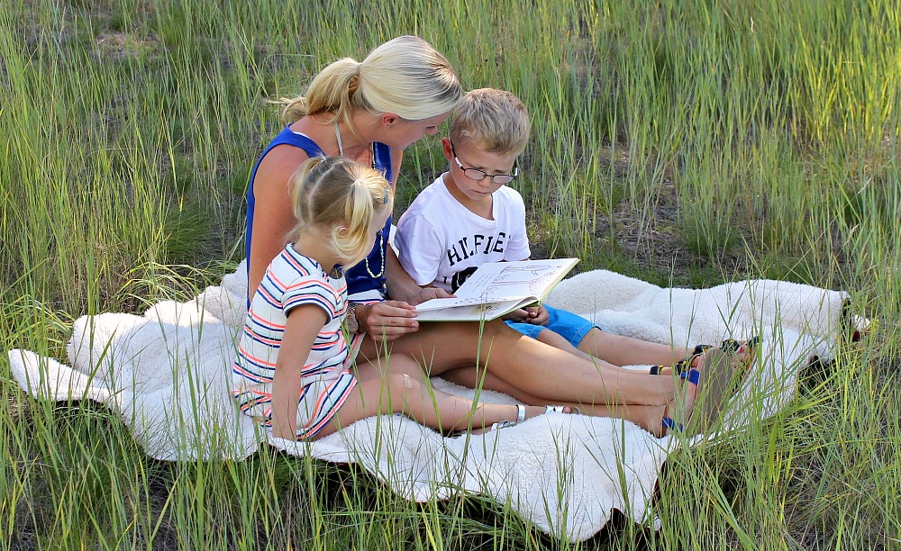 family chill out time reading in the fields together summer travels