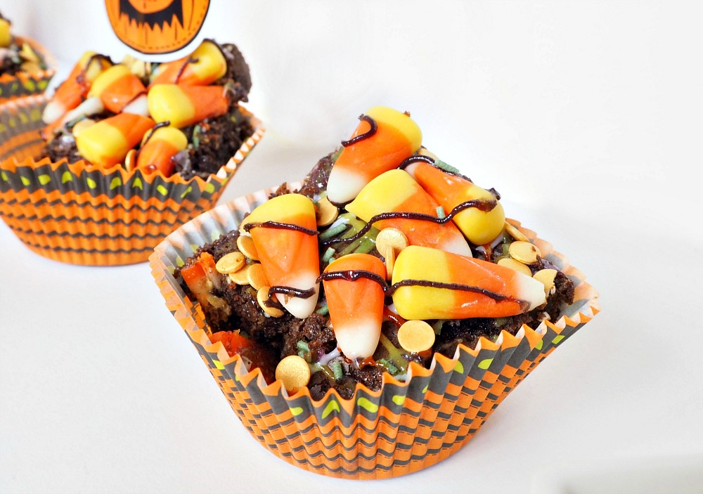 A cupcake case filled with a candy corn brownie