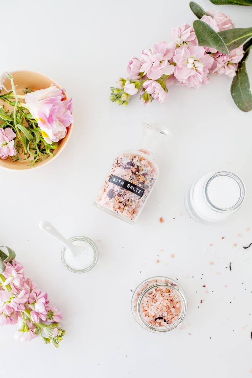 set of jars of bath salts composed with gentle matthiola incana flowers