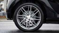 tyre safety tips close up photograph of chrome vehicle wheel