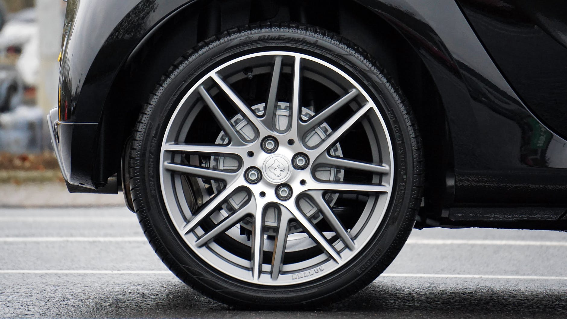 close up photograph of chrome vehicle wheel