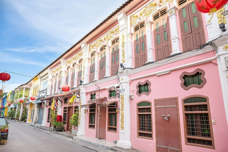 Phuket Old town filled with pink and yellow old style buildings with beautiful architecture.