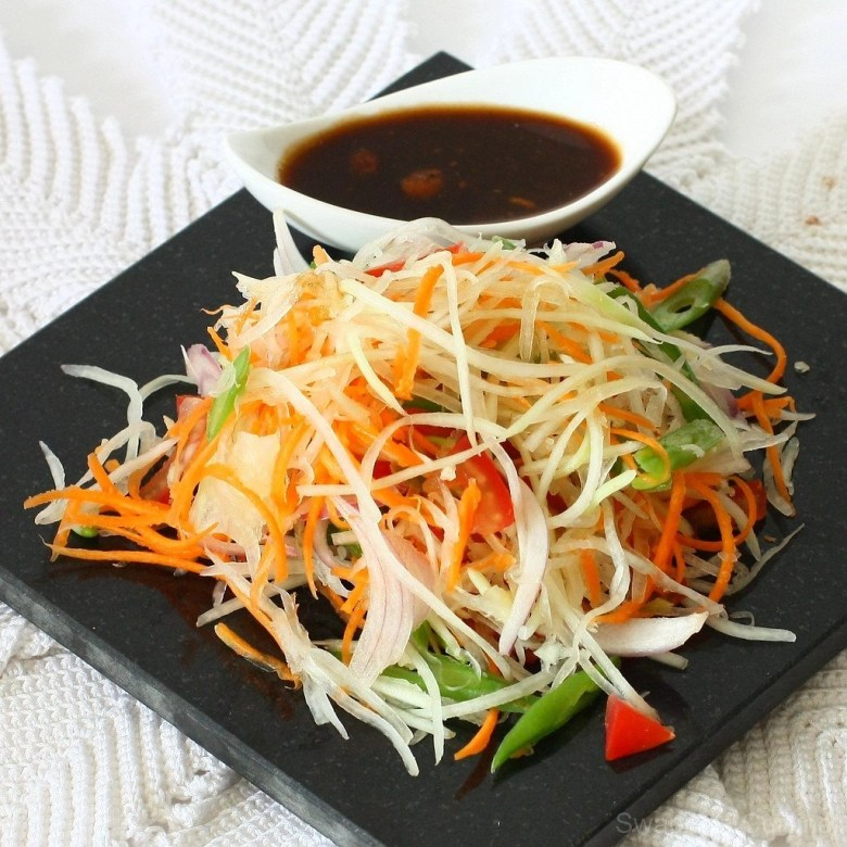 Som Tam is a green papaya salad perfect for a hot day in Thailand