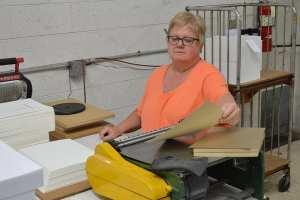 Cynthia, working on the duplexing machine.
