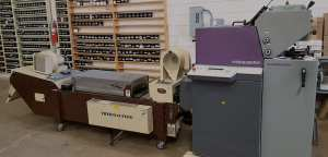 Two color Heidelberg printing press with the thermography machine.