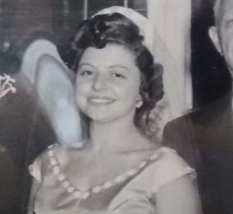 This is her on her [second] wedding day. (She and my grandfather eloped, and then had another wedding for the family.) Strikingly like me, right?