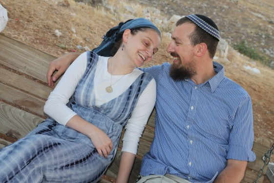 This criminally adorable couple, for example. Eitan is wearing a kippah and tzitzit with the fringes hanging out (you can see the knots from one of them next to the edge of his shirt...). My hair is mostly covered, sleeves past the elbow, modest neckline, skirt past the knee.