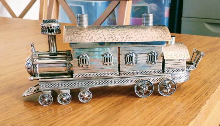 photo of silver train engine