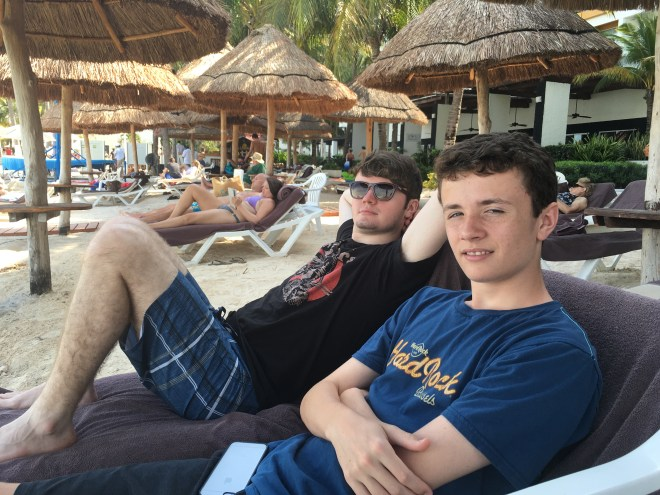 Gavin and Riley chilling  on the beach at the resort in Cancun.