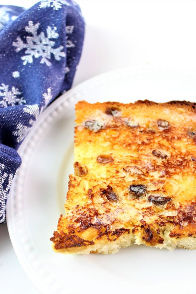 toasted piece of panettone spread with butter