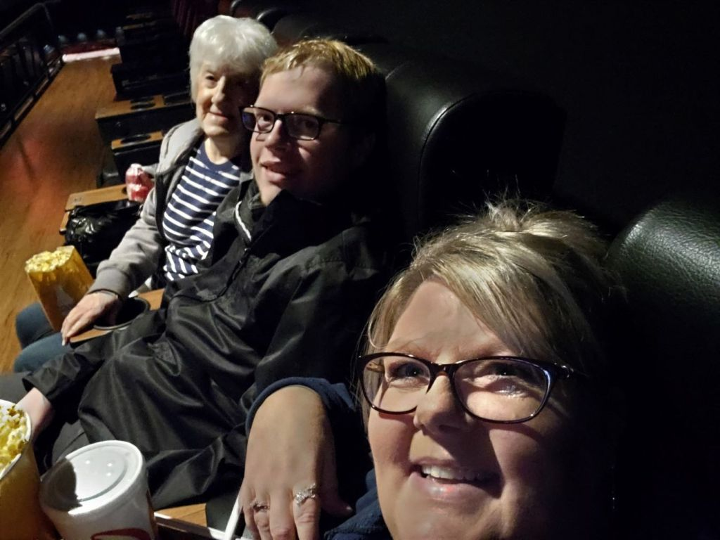 me, mom, and Brandon at the movies