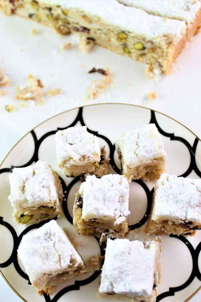 stollen bars cut into squares and placed on white and black plate