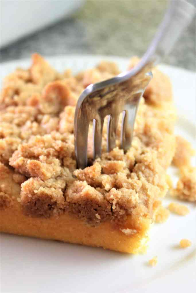 gluten free crumb cake piece with a fork in it