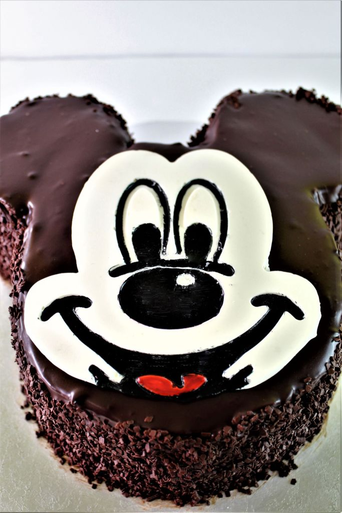 side angle view of mickey mouse cake