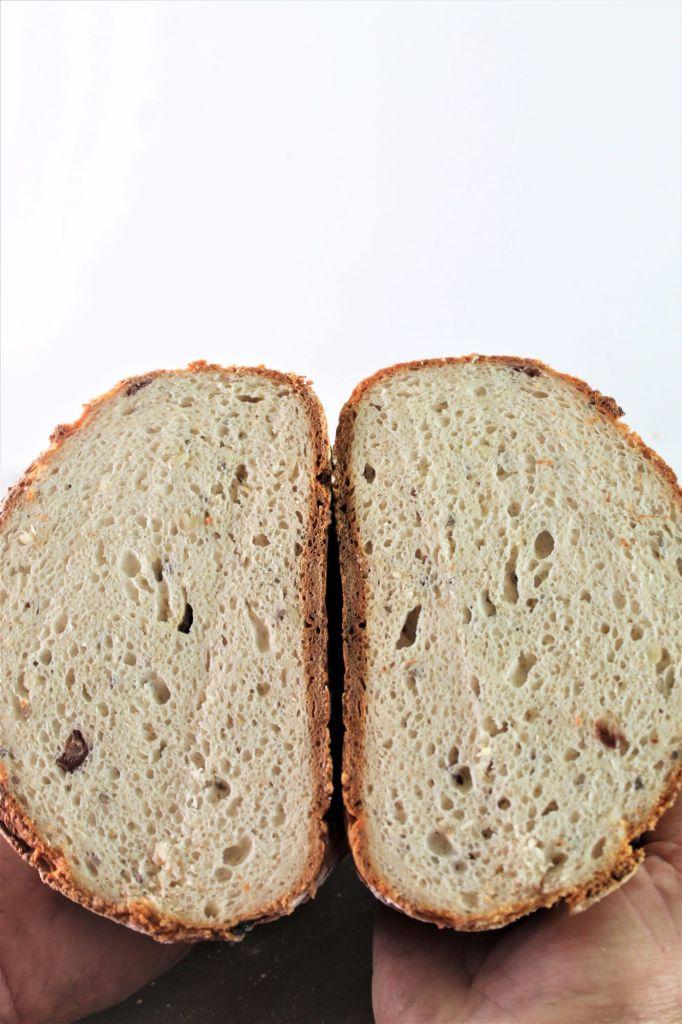 multigrain nut and seed sourdough bread cut in half